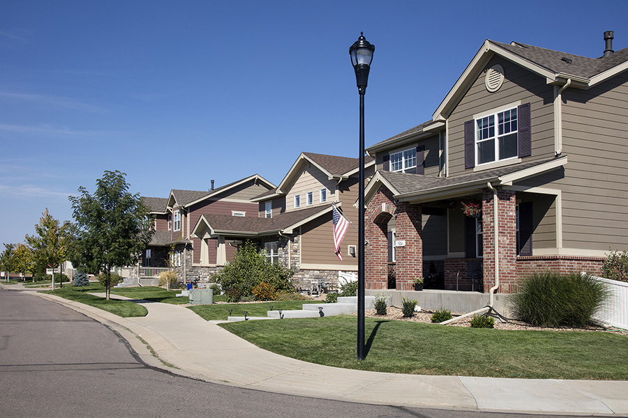 Longmont neighborhood with paved sidewalks, lush landscaping, and two story houses.